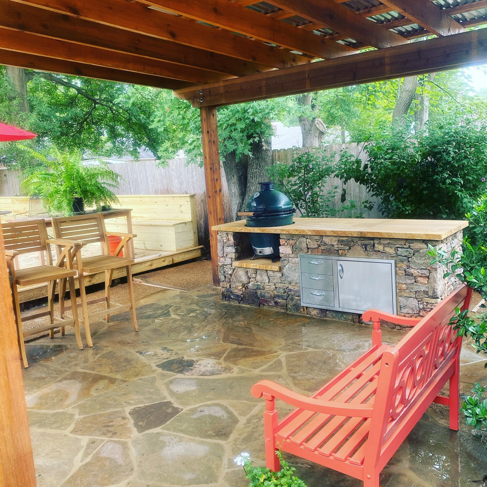 Flagstone Patio, Fieldstone Kitchen, Cedar Pergola w/metal Roof, Deck, and Drainage